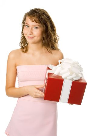 beautiful young woman in pink dress with a box of gift over white background photo