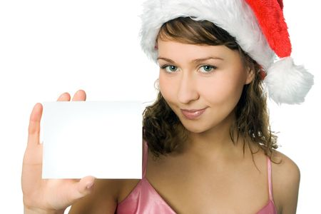 young woman in santa hat with white blank card on white background photo