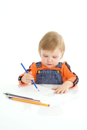 Little girl drawing with color pencil over white background photo