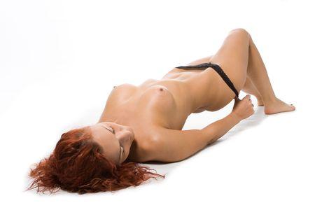 redheaded femme nue avec des seins nus psnts d�coller sur fond blanc  Banque d'images
