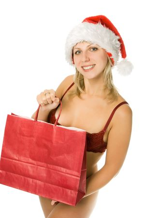 Woman wearing Santa hat and lingerie, holding a shopping bag isolated over white background photo