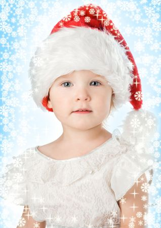 pretty  in santa claus christmas red hat and snowflake photo