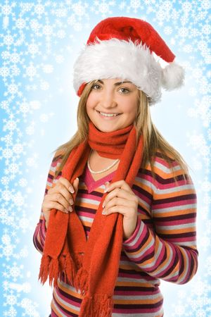 starlet: christmas girl in red hat and scarf and snowflake and starlet Stock Photo