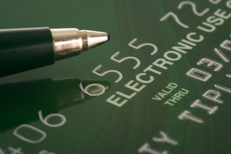 expire: credit card with pen financial background