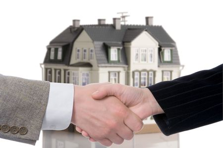 consent: handshake arrangement buying - selling of house over white background Stock Photo