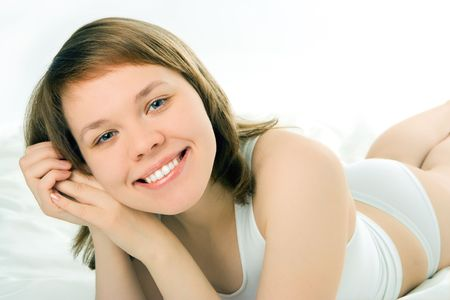 Fresh and Beautiful woman on bed  Stock Photo