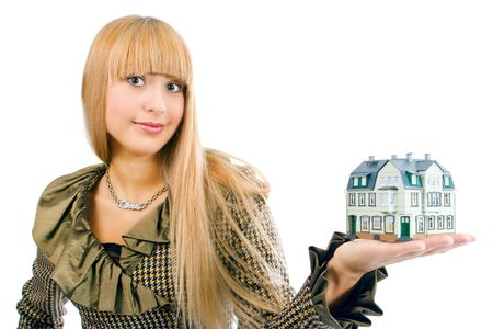 business woman with house on hand Stock Photo - 2495714