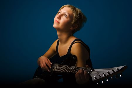 music woman with guitar on blue photo