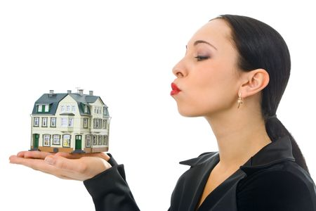 woman with little house on hand Stock Photo - 2495638