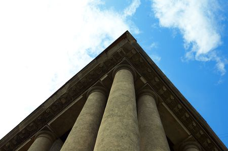 column construction under blue sky with clouds photo