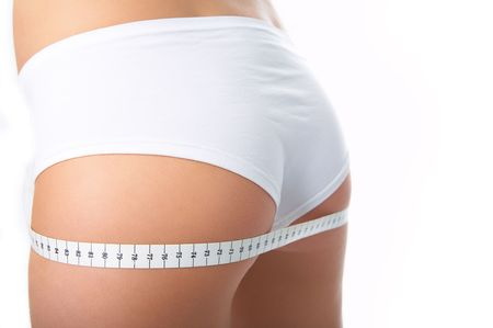 girl ass: woman measure ass om white background Stock Photo
