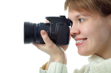 woman photographer with photo camera on white background photo