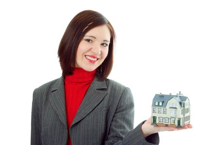 business woman hold little house on hand over white background photo