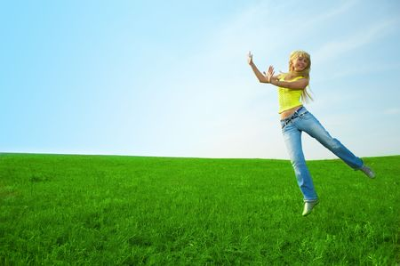 herbage: happy  young woman jump in field with green grass