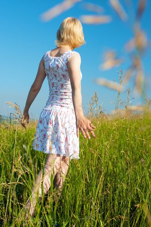 woman in field under blue sky Stock Photo - 3288466