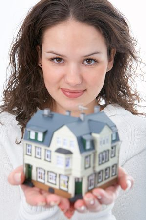 woman with little house in hand on white background Stock Photo - 3847300
