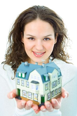 woman with little house in hand om white background photo