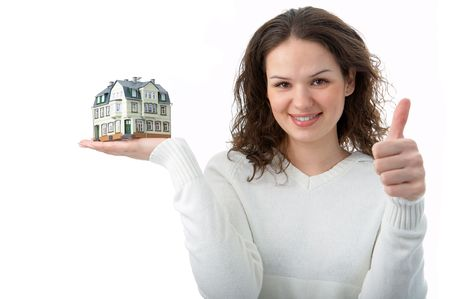 woman with little house on palm over white background photo