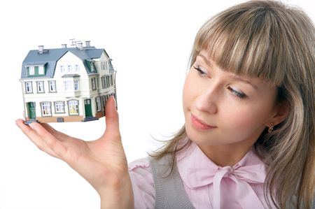 woman with little house on hand over white background photo