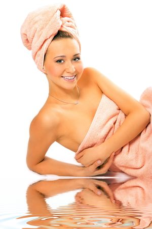 spa young pretty girl in towel after shower on white background photo