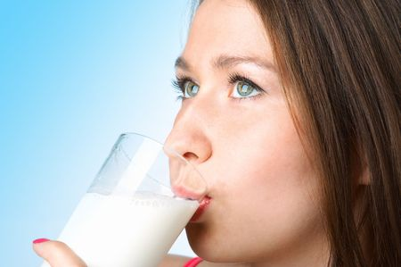 woman with glass milk on blue background