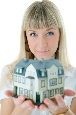 architect woman with little house on hand over white background photo