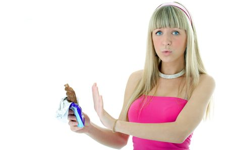 blonde woman rejection of chocolate on white background photo
