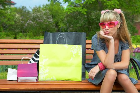 shoppingbag: shopping blond woman in pink glass with shoppingbag Stock Photo