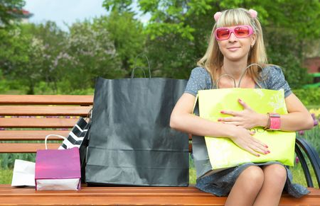 beauty shopping blonde girl with paper bag photo