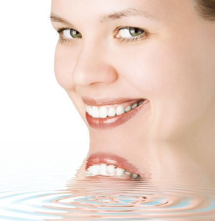 close-ups joyful face girl looks in staff and wide smile white teeth in water with ripples photo