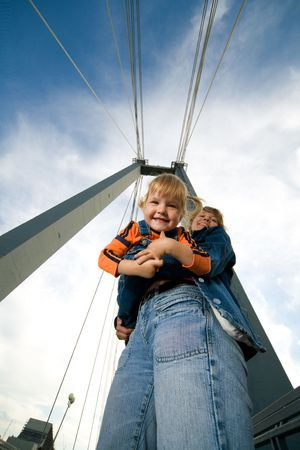 foreshortening: mother hold child on bridge outdoor