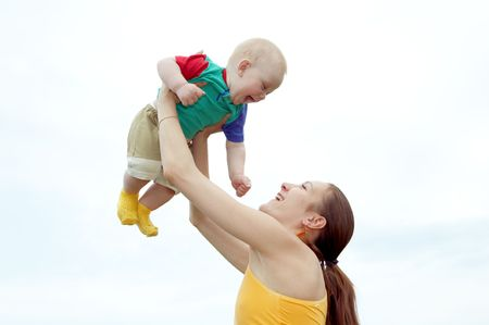 Mother with  baby  on the  sky Stock Photo - 3858762
