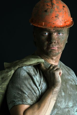 COAL MINER: close-up portraitm worker man mine
