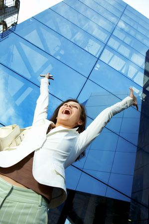 hurray: success business woman on office building