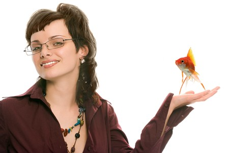 pretty brunette girl in glasses with fish portrait on white background photo