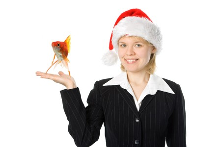 business woman with fish in red santa hat over white background photo