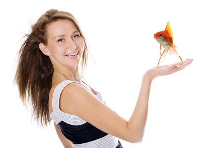 Young beautiful  woman with fish over white background photo