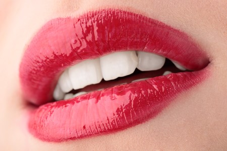 dentition: lips of a beautiful young woman Stock Photo