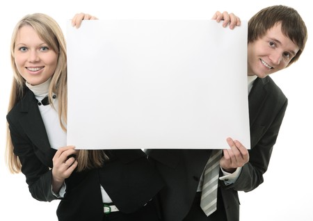Two young people holding a white sign  on white background Stock Photo - 4249022