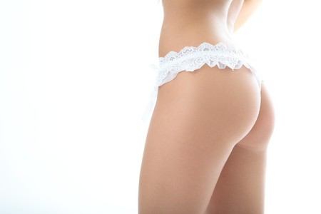 woman back in panties on white background Stock Photo - 4248494
