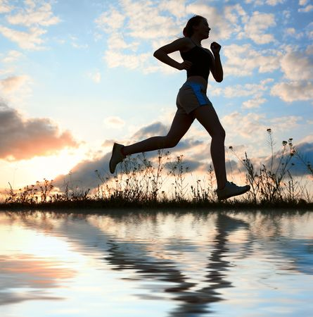 runner silhouette: Silhouette woman run under blue sky with clouds and sun Stock Photo