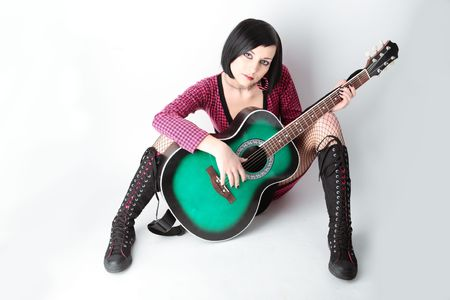 beauty emo girl with guitar on black background photo