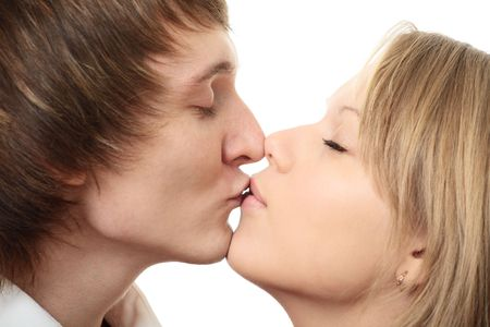 couple young man and woman kissing on white background photo