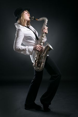 woman play on saxophone on black background Stock Photo - 5526407
