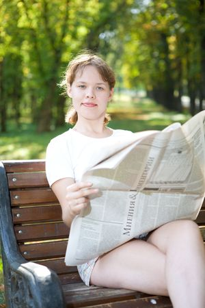 woman with newspaper in park Stock Photo - 5526658