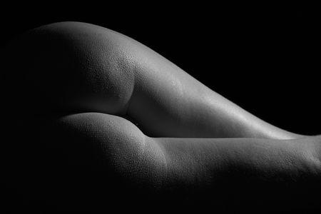 female body on black background