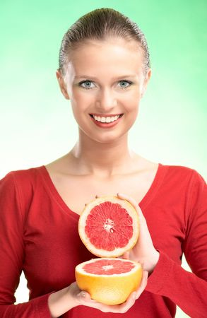 young beauty woman with grapefruit on green background Stock Photo - 5526591