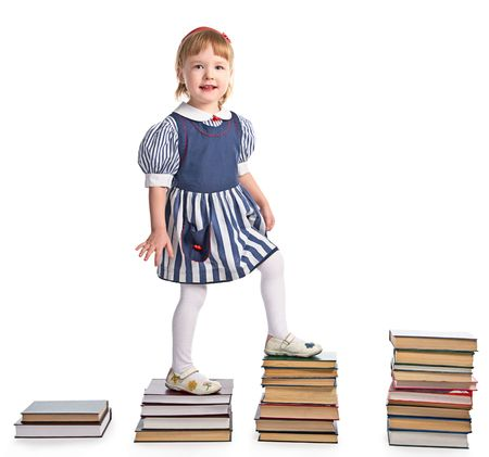 girl  walking from stairs of book piles on white background photo