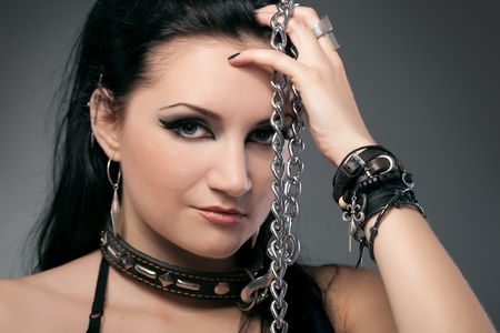 young naked woman in chain on black background Stock Photo - 8359199