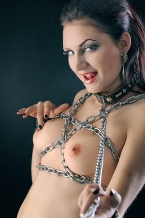 young naked woman in chain on black background Stock Photo - 8361197